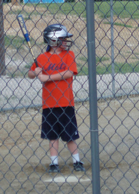 Child Playing Little League Baseball