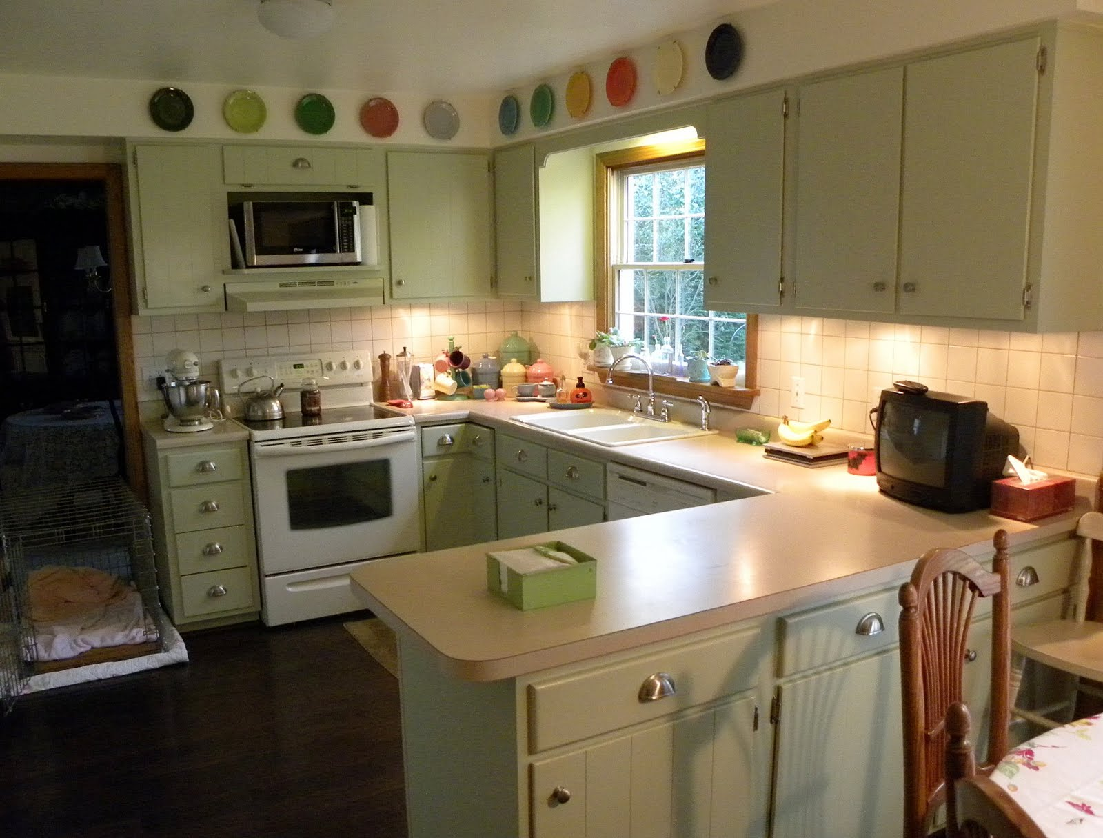 Soft Green Kitchen Cabinets