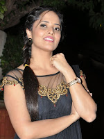 Anasuya in Black Dress Stills-cover-photo