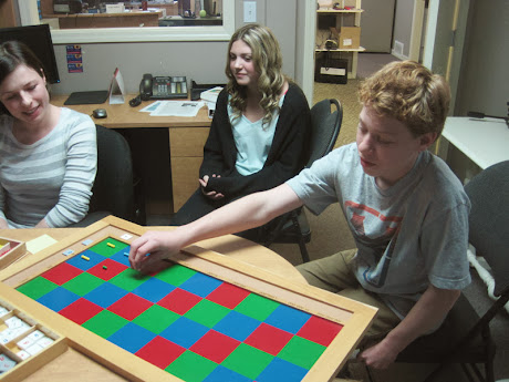 NAMC montessori training take your child to work day working with checkerboard
