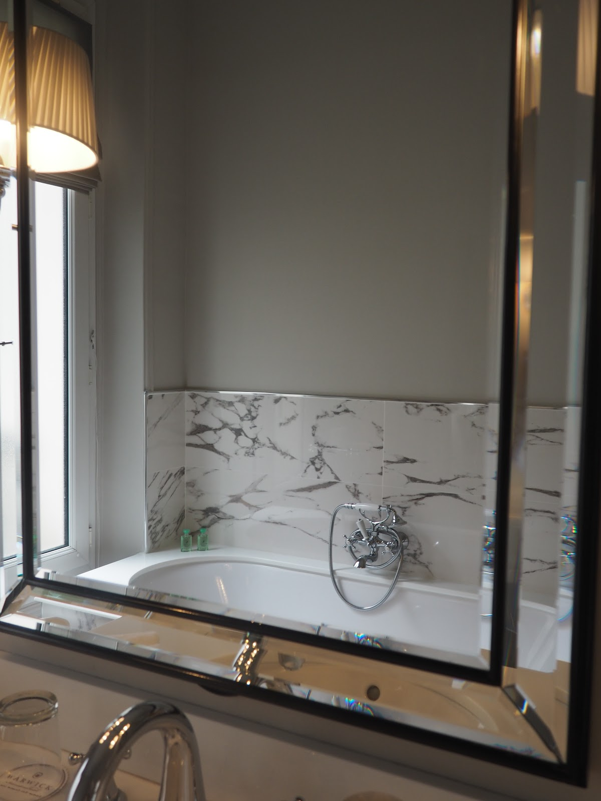 marble bathroom through the mirror Saint-Honore-Suite, Hotel Westminster, Paris