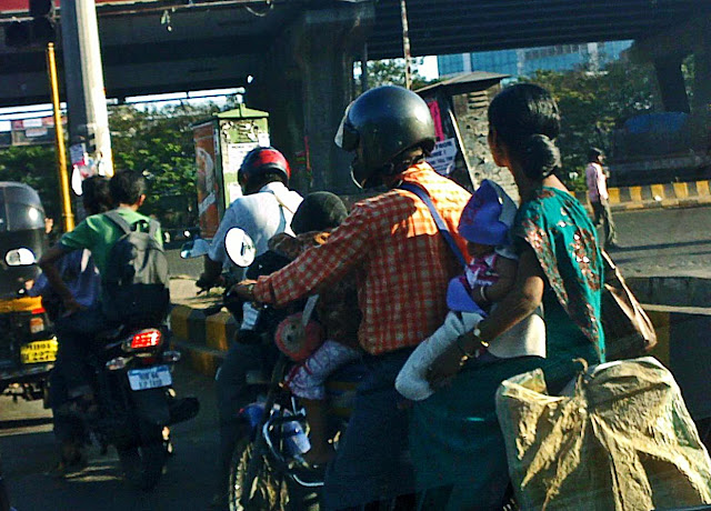 couple with toddler and baby on bike
