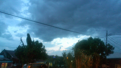 The cloudy evening sky..