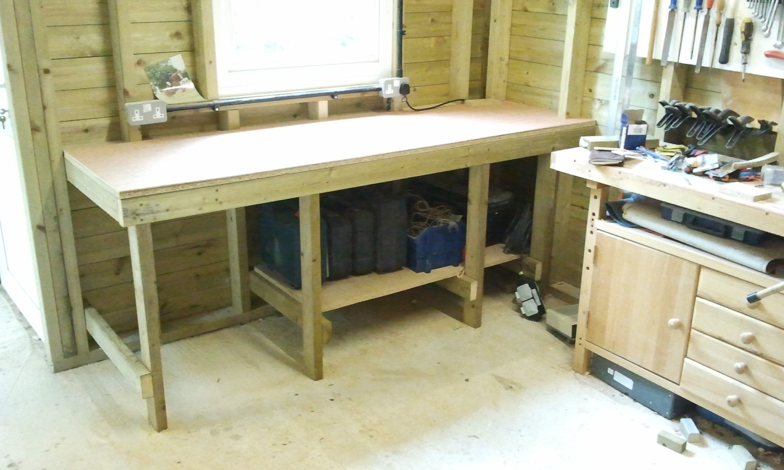 daisy grace wheels on the dinghy and new workbench in the