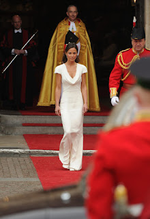Philippa Middleton, sister of Kate Middleton and Maid of Honor, arrives in a cowl neck Alexander McQueen gown.