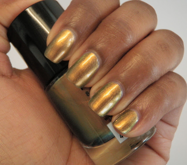 Review and swatches nail polish by Catrice Genius In The Bottle gold.
