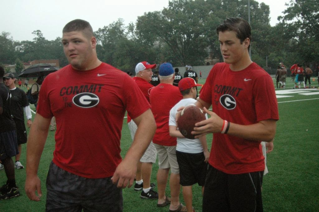Georgia lands its first 2016 recruiting class members with commitments from QB Jacob Eaton and OT Ben Cleveland.