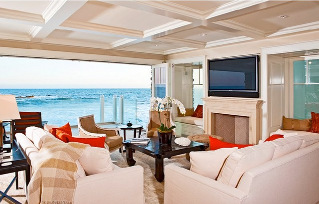 white slipcover sofas, bright coastal room with an ocean view