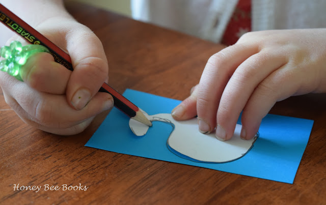 Tracing the whale shape onto the card stock for making a whale paper clip bookmark
