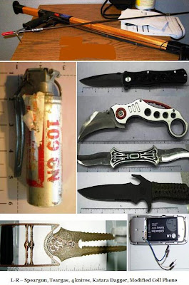 Spear gun, live tear gas grenade, knives, modified cell phone. 