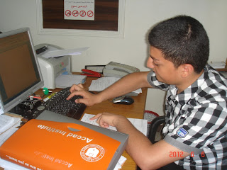 young boy with disability learning to use to the computer