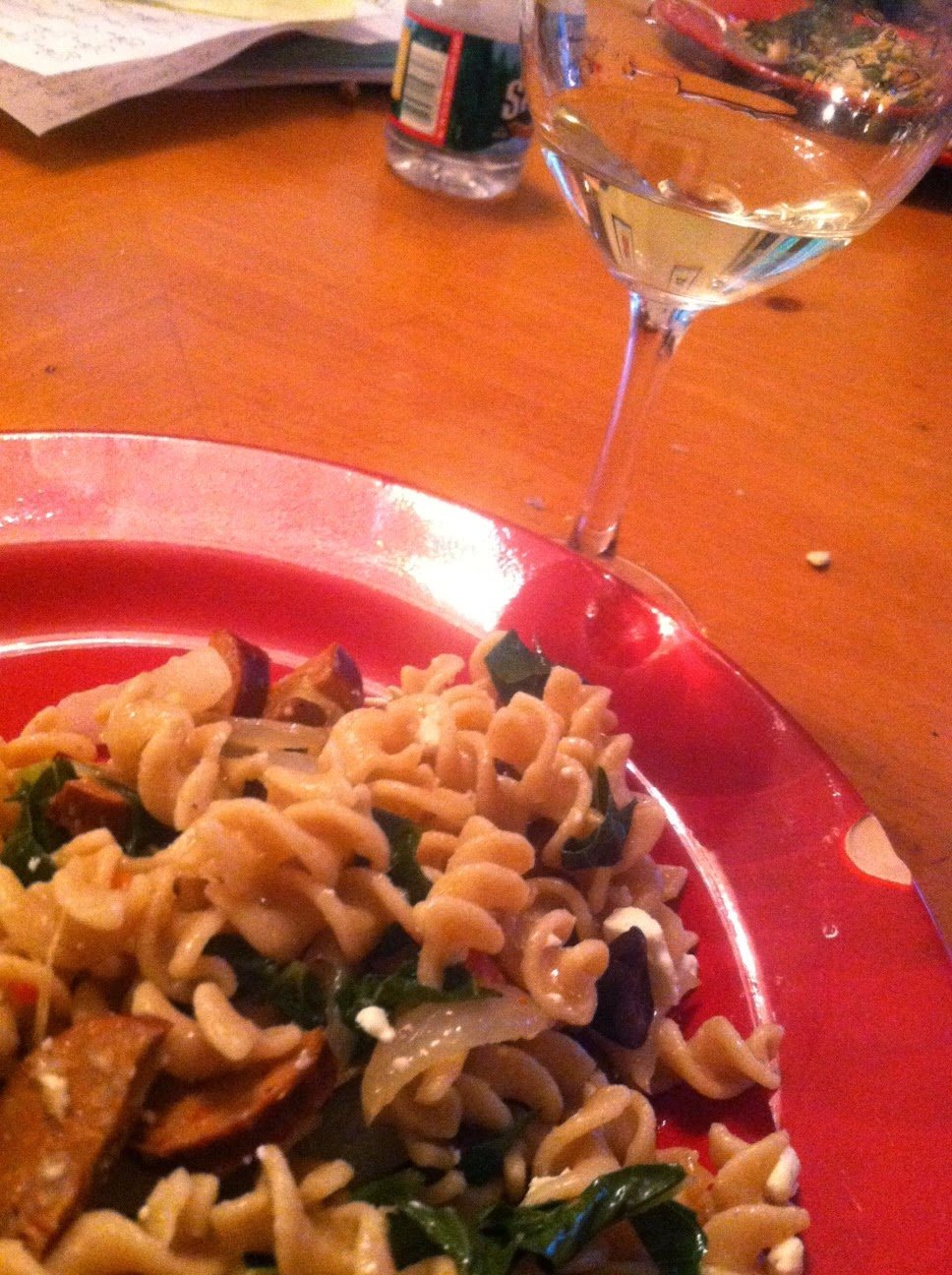 Pouilly Fumé paired with pasta with andouille sausage and collard greens.