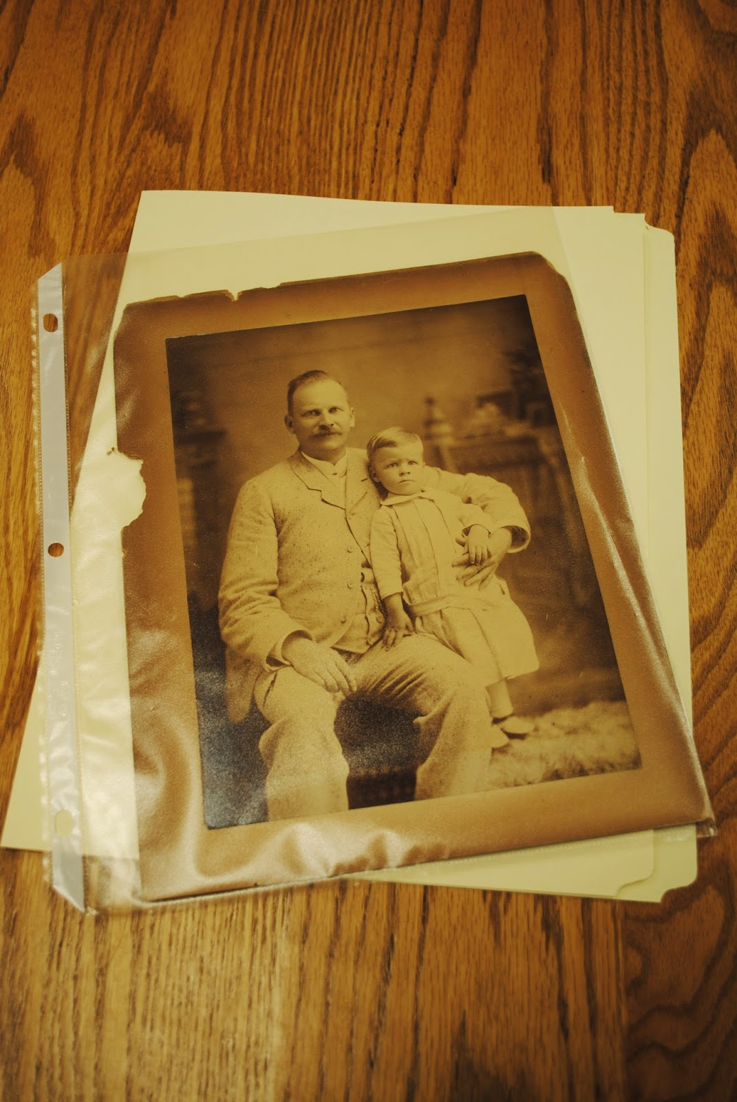 family photo in polyethylene plastic sheet and acid-free file folder