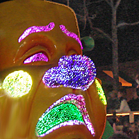 Mardi Gras Light Up Float with Crowds Catching Beads