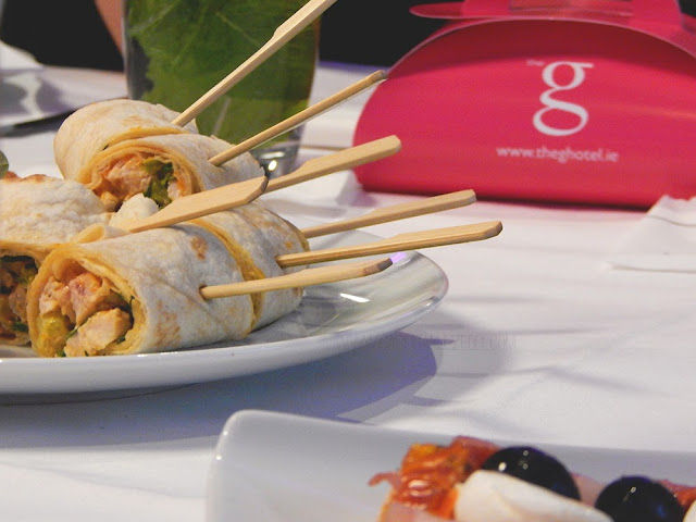 Chicken wraps with a pink box in the background with the G Hotel Logo on it