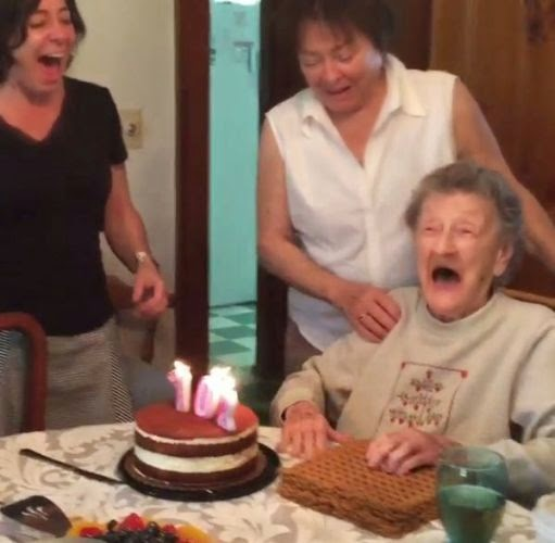 ... granny blows out her teeth as she tries to blow out her birthday