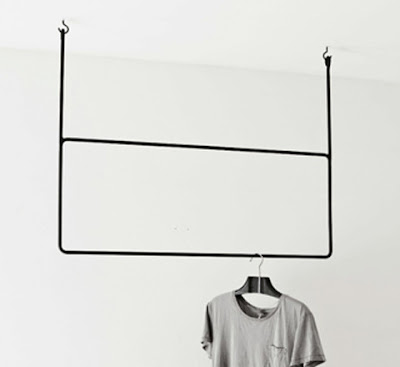 clothing rack that hangs from the ceiling