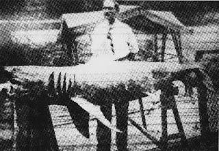 Michael Schleisser posando con su tiburón