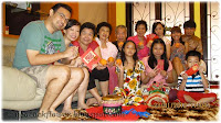 Group photo of family and relatives at Say Bee and Colin's home