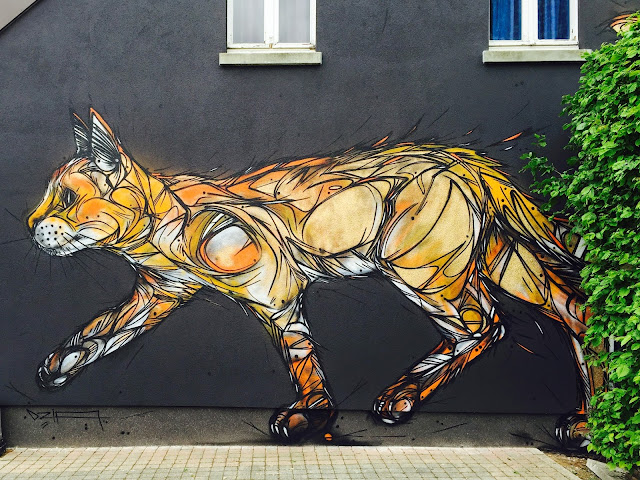 While you discovered his latest pieces in Turin a few days ago, DZIA is now back in Belgium where he directly queued a new cat mural in the city of Zolder.