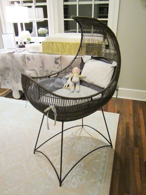 Close up of the crescent moon shaped bassinet from Kenneth Cobonpue's rattan furniture collection