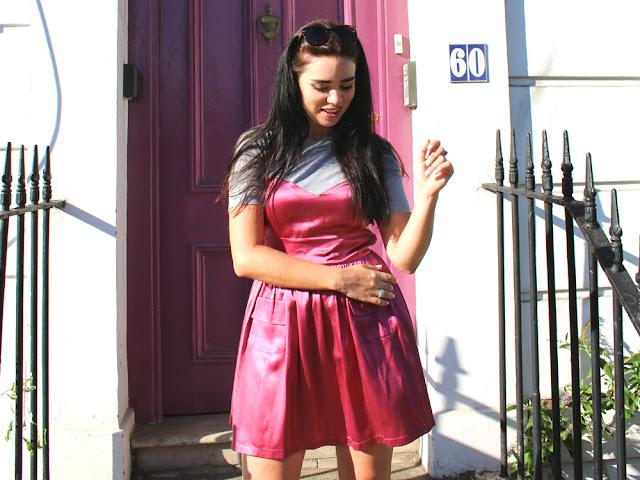 London fashion blogger Emma Louise Layla in pink satin dress in Camden