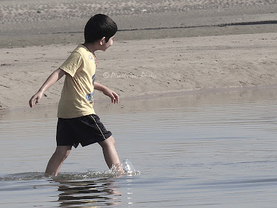 A boy playing at Aksa beach