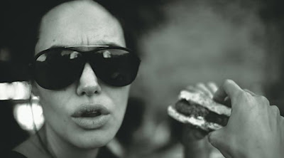 angelina jolie enjoying a hamburger