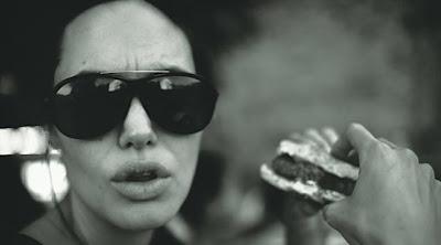 angelina jolie enjoying a hamburger