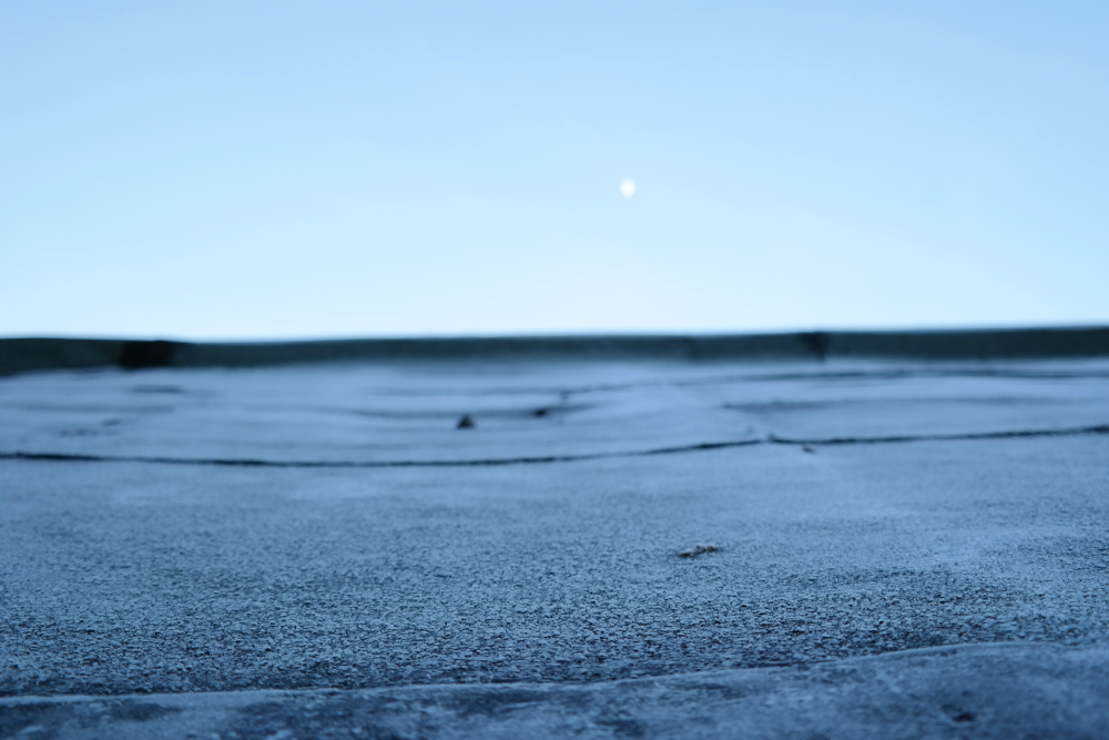 Frost on shed roof, moon in the sky