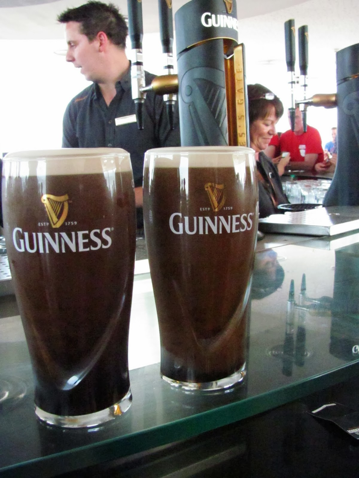 Two pints of Guinness ready to drink on the top floor of the Guinness Storehouse, Dublin, Ireland