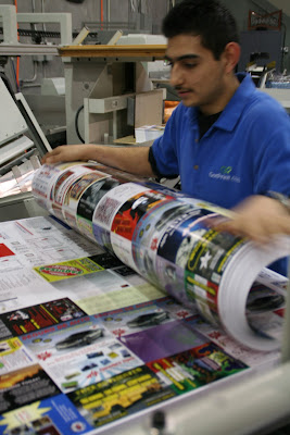 employee preparing gang-run batches for offset printing at GotPrint