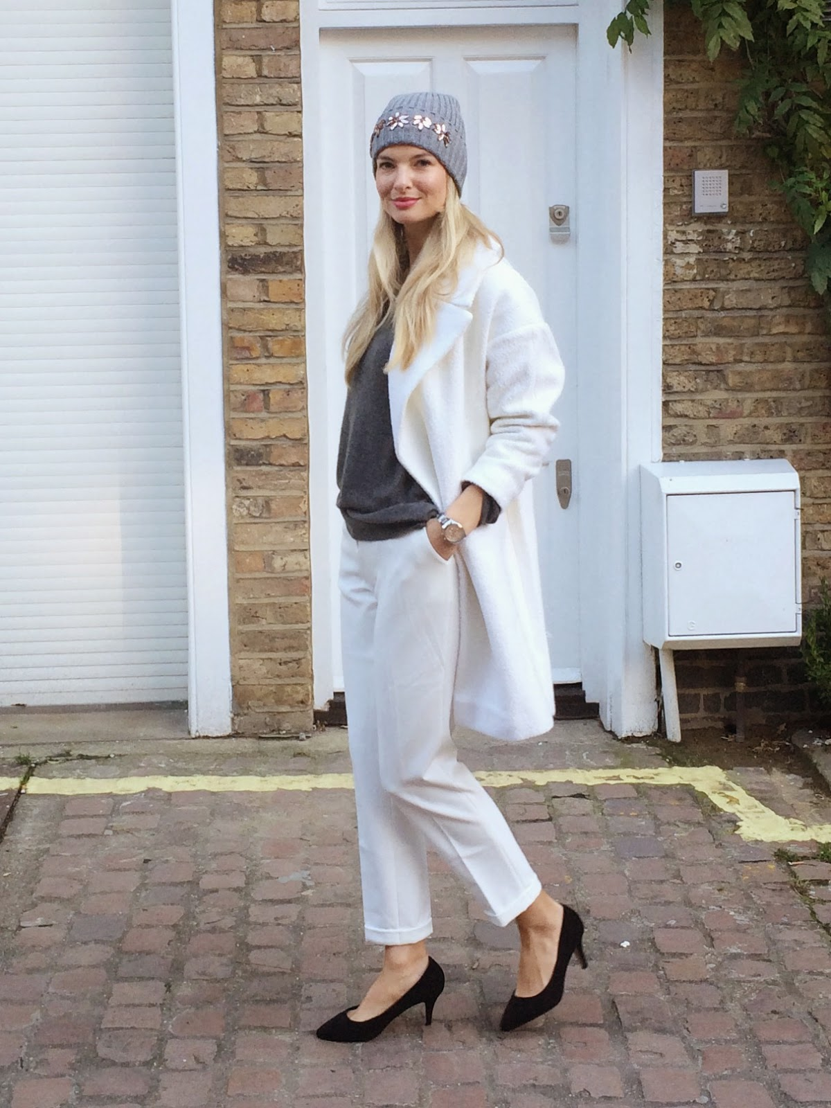Beanie, embellished beanie, white coat, winter white look, asos coat, slouchy coat, oversize coat, grey jumper, boyfriend jumper, tailerd trousers, white trousers, kurt geiger heels, blonde hair, fashion blogger, streetstyle, street style london