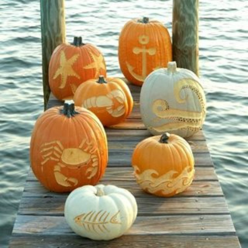carved pumpkins with coastal designs