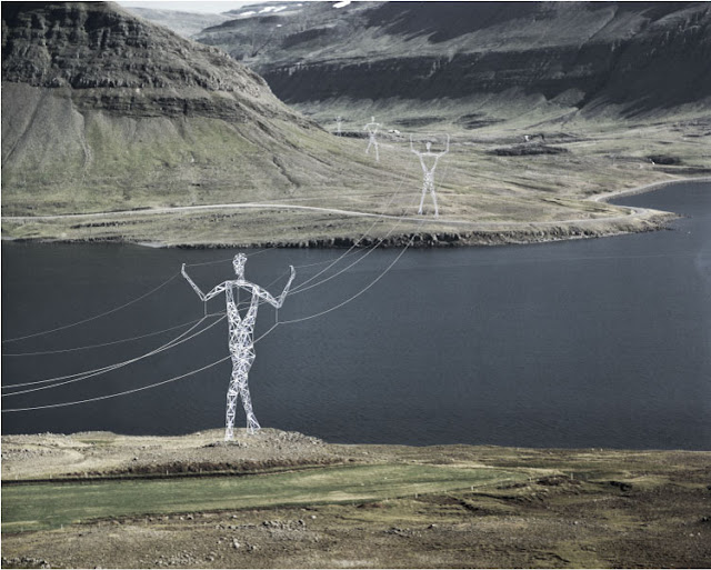Photo of pylons holding the wires through the landscape