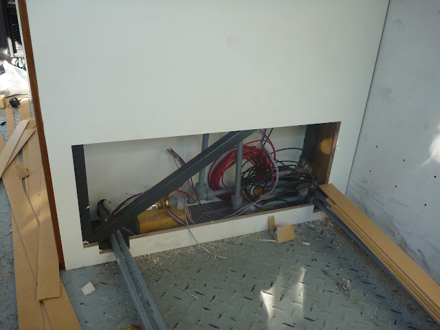 A close up of the hatch to access the plumbing fittings behind the bathroom