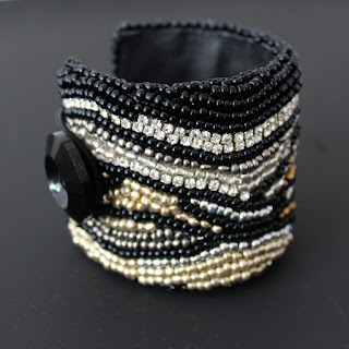 Bead Embroidered cuff bracelet in gold, black,silver and diamante