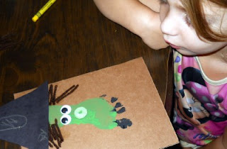 halloween craft for kids: witch's face from a footprint