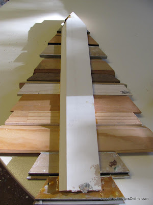 making Christmas trees using repurposed and recycled picture molding