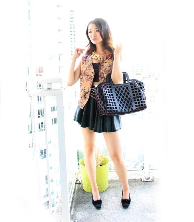 Vancouver Fashion blogger Jasmine Zhu wearing leather croptop and leather skater skirt with gold accent jewelery and vanlaced avenue bag, fall transition outfit