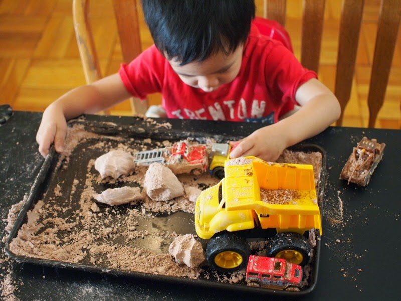 boy playing with pretend dirt dough