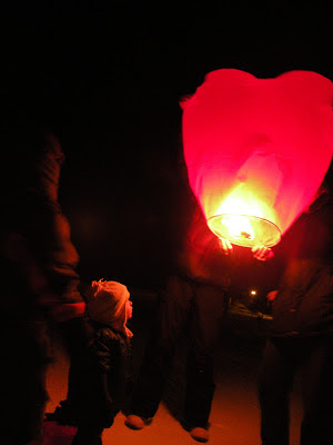 Love Ignites.  Lighting Love Lanterns on a January evening, -17°F.