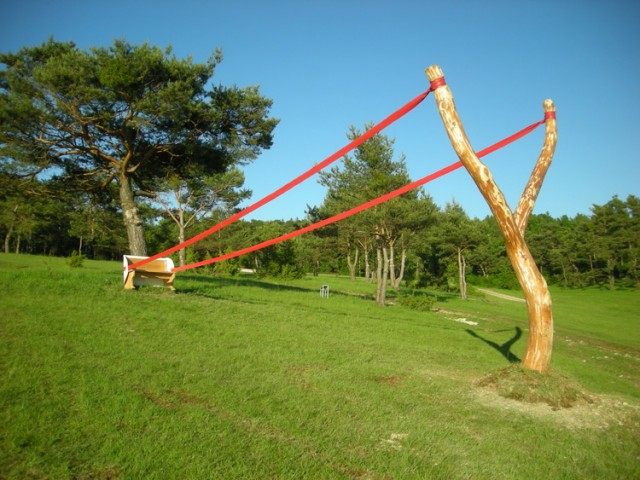 Follow the lines here are written giant slingshot for Outdoor pool sculptures