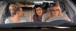 Penny, Amy and Bernadette in Bernadette's car. She's driving, Penny's in the front passenger seat, and Amy's in the back.