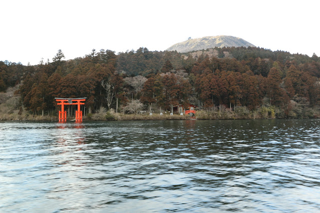 Hakone Shrine resembles Itsukushima Shrine (the floating torii gate) at Miyajima Island while cruising along Lake Ashinoko in Japan