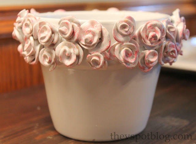 Glazed ceramic flower pot with roses.