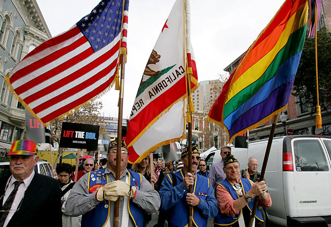 in San Diego's gay pride parade with American flags and rainbow banners, .