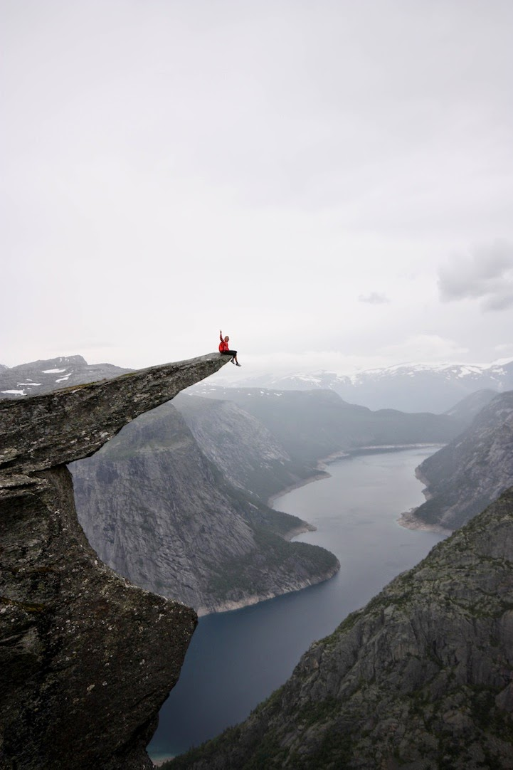 "Thousands of visitors come each year to sit ""on top of the world,"" and with no safety rails, Trolltunga is one of those ""bucket list"" experiences that's not for the faint hearted. - Getting To This Place Is Extremely Difficult… But 8-10 Hours Later, It'll Blow You Away."