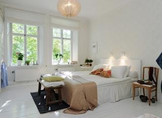 cozy scandinavian bedrooms 6 554x405 Dekorasi kamar tidur untuk cuaca dingin