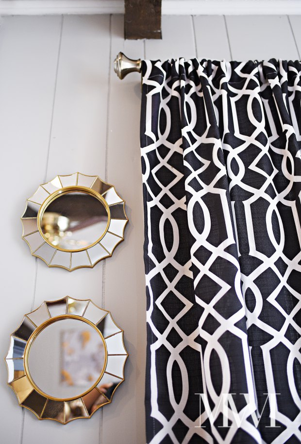 A beautiful use of bold black & white imperial trellis curtains paired with an antique brass curtain rod. All the decor is from the BHG line at Walmart and comes in under $50.